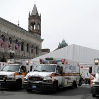 Dr. Joshua Liao on the lessons he learned from the 2013 Boston Marathon medical response. In this photo, ambulances sit outside the medical tent at the Boston Marathon finish line, Monday, April 15, 2013. (Elise Amendola/AP)