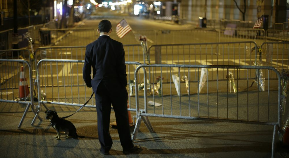 Carol Rose: Let's use the Marathon anniversary to reflect on lessons learned. In this photo, a man pauses on Boylston Street near the Marathon finish line, Wednesday, April 17, 2013. (Matt Rourke/AP)