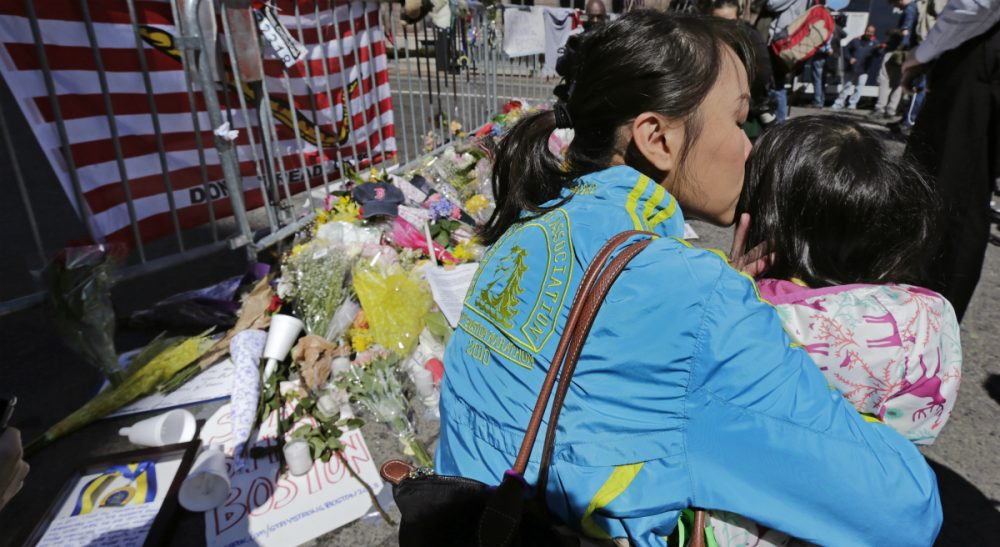 Sharon Brody: Worrying is folly. It represents a flailing effort to gain, or to pretend to gain, some power over theunpredictable comings and goings of life. In this photo, Boston Marathon runner Vu Trang, of San Francisco, kisses her two-year-old daughter Cara at a makeshift memorial on Boylston Street, April 17, 2013. (Charles Krupa/AP)