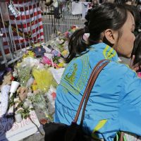 Sharon Brody: Worrying is folly. It represents a flailing effort to gain, or to pretend to gain, some power over the unpredictable comings and goings of life. In this photo, Boston Marathon runner Vu Trang, of San Francisco, kisses her two-year-old daughter Cara at a makeshift memorial on Boylston Street, April 17, 2013. (Charles Krupa/AP)