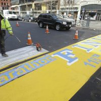 In this photo, Eric House applies a fresh coat of paint to the Boston Marathon finish line on Boylston Street in Boston, Tuesday, March 25, 2014. The 118th running of the Boston Marathon will occur on April 21, 2014. (Stephan Savoia/AP)
