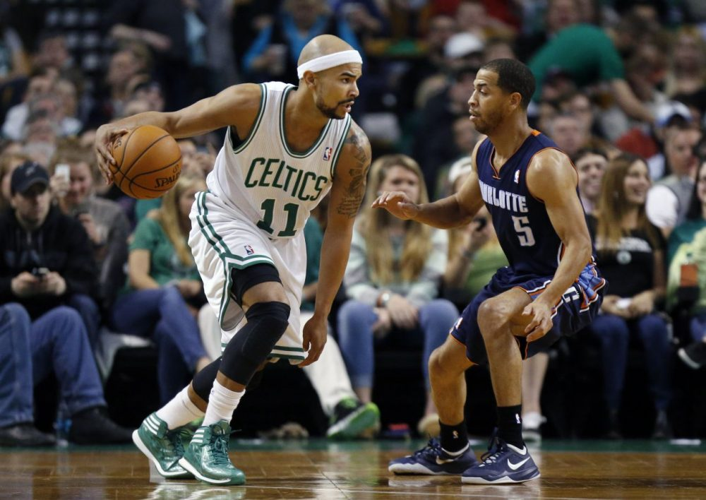 Boston Celtics' Jerryd Bayless (11) looks to move against Charlotte Bobcats' Jannero Pargo (5) in the first quarter of an NBA basketball game in Boston. (Michael Dwyer/AP)