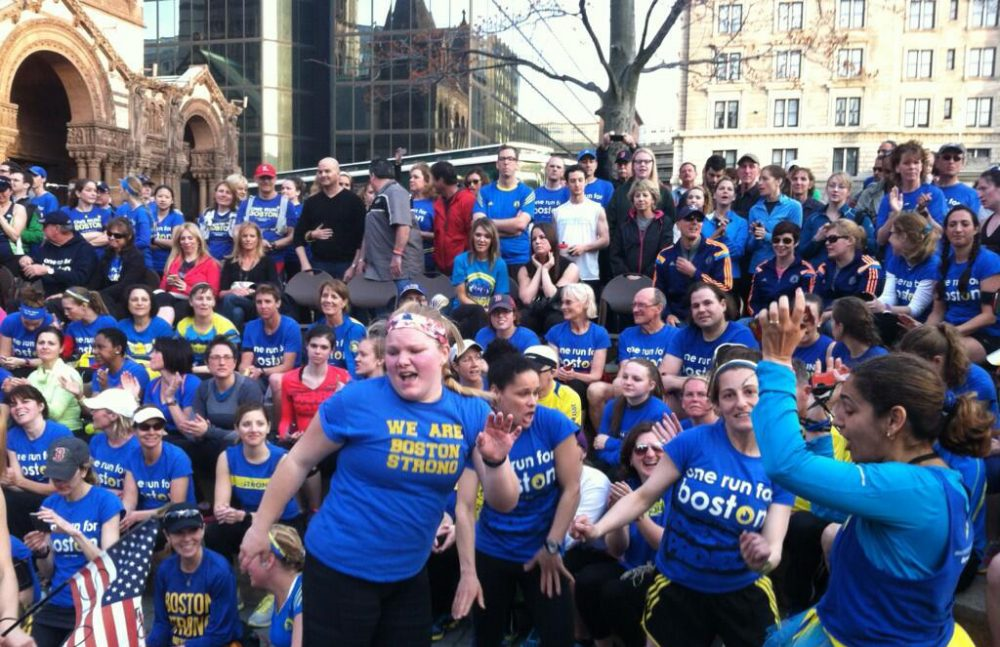 Runners celebrate at the conclusion of the One Run For Boston. (Jack Lepiarz/WBUR)