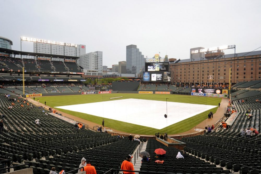 Professional baseball teams use tarps to protect their fields. (Mitchell Layton/Getty Images)