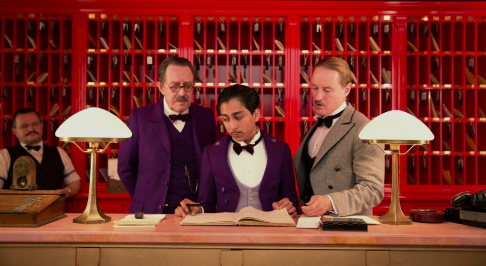 """Does our cultural appetite for """"true stories"""" in art suggest that we are starved for them in cyberspace? This image released by Fox Searchlight shows Tom Wilkinson, Tony Revolori, center, and Owen Wilson, right, in """"The Grand Budapest Hotel."""" (AP)"""