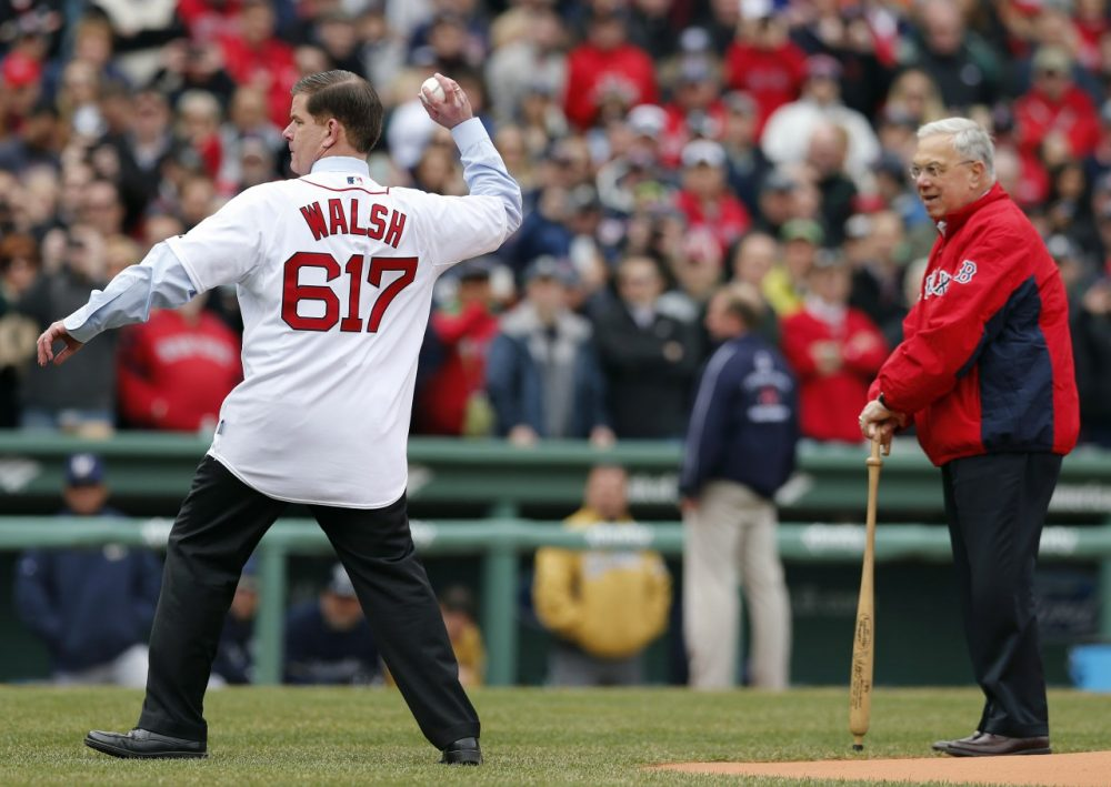 Boston Mayor Marty Walsh throws the ceremonial first pitch as his predecessor in office Tom Menino looks on before a baseball game between the Boston Red Sox and the Milwaukee Brewers. (Michael Dwyer/AP)