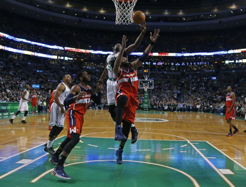 Washington Wizards forward Nene Hilario (42) and Boston Celtics center Joel Anthony (50) compete for a rebound as Wizards guard John Wall (2) and Celtics guard Phil Pressey (26) stand at left. (AP/Elise Amendola)