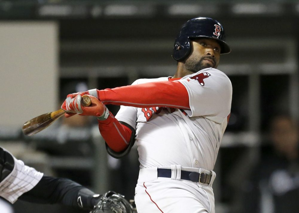 Boston Red Sox's Jackie Bradley Jr. hits a two-run double off Chicago White Sox second baseman Leury Garcia, who was pitching in relief, during the 14th inning. (AP/Charles Rex Arbogast)