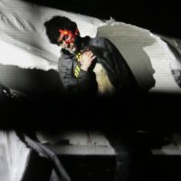 In this Friday, April 19, 2013, file photo provided by the Massachusetts State Police, Boston Marathon bombing suspect Dzhokhar Tsarnaev leans over in a boat at the time of his capture by law enforcement authorities in Watertown, Mass. (Sean Murphy/AP)