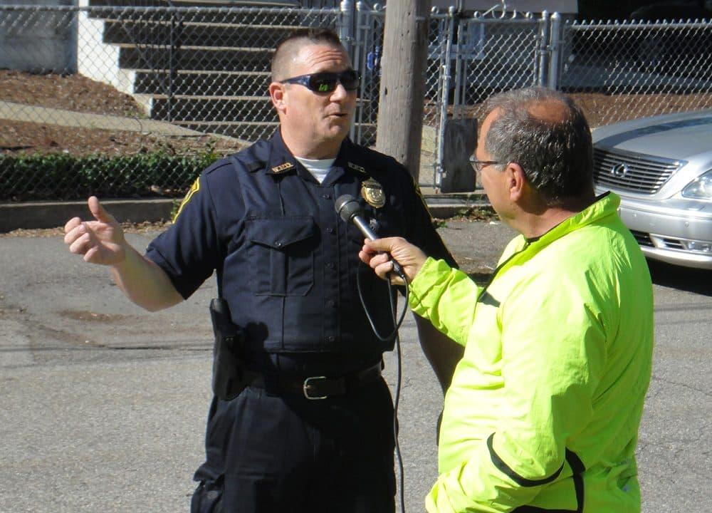 WBUR's Bruce Gellerman interviews Watertown Sgt. John MacLellan. (Jon Peck/WBUR)