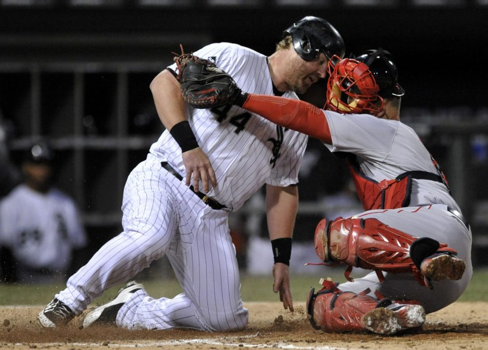 Boston Red Sox catcher David Ross, right, tags out Chicago White Sox's Adam Dunn (44) at home plate during the seventh inning. (AP/Paul Beaty)