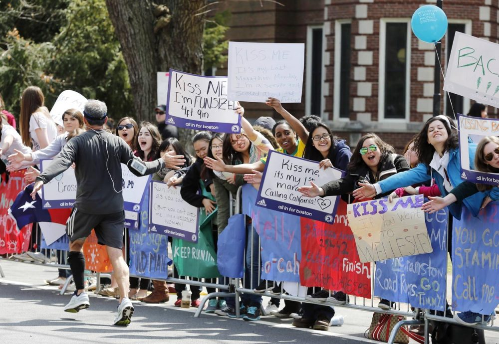 Wellesley College students cheer the runners during the 2013 Boston Marathon. (Michael Dwyer/AP)