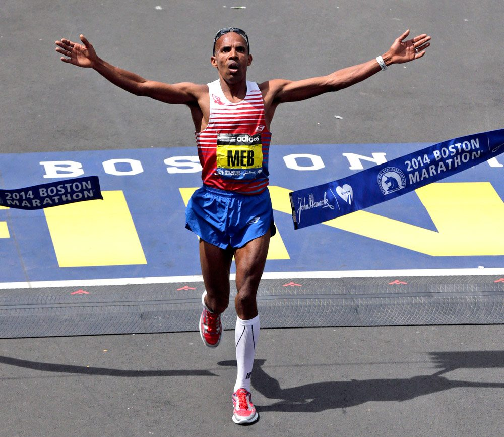 Meb Keflezighi, of San Diego, Calif., breaks the tape to win Boston Marathon.