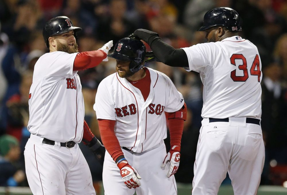 David Ortiz (34) and Mike Napoli, left, celebrate after scoring a on a three-run home run by Jonny Gomes, center, in the sixth inning. (Michael Dwyer/AP)