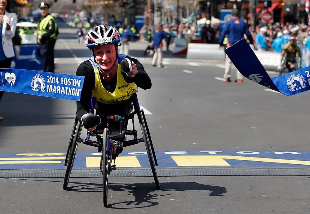 Tatyana McFadden, of the U.S., breaks the tape to win the women's wheelchair division of the 118th Boston Marathon. (Elise Amendola/AP)