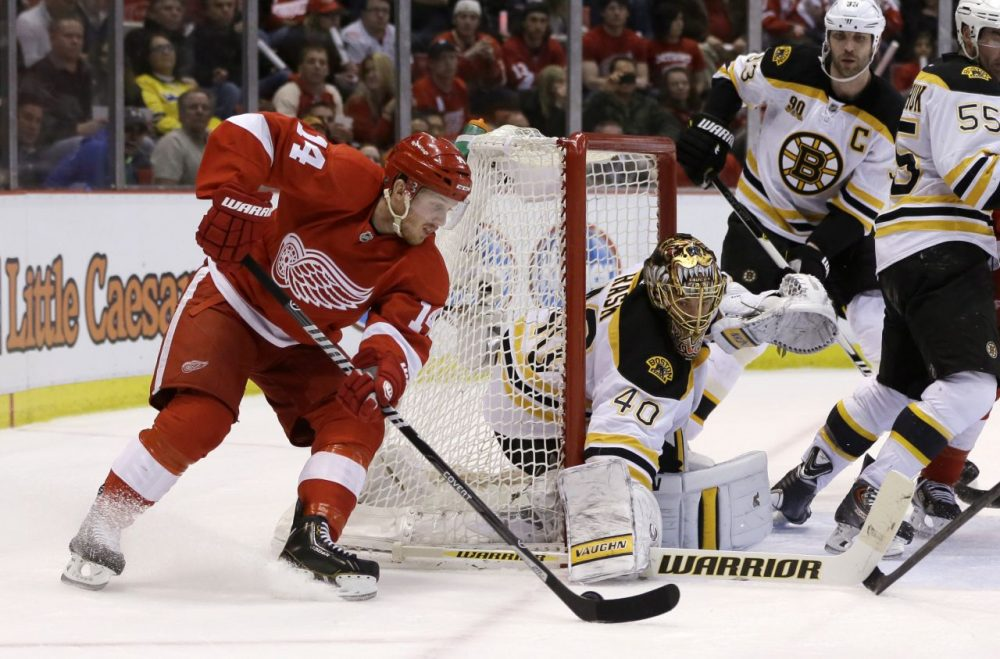 Boston Bruins goalie Tuukka Rask (40) of Finland, stops a goal attempt by Detroit Red Wings center Gustav Nyquist (14). (AP/Carlos Osorio)