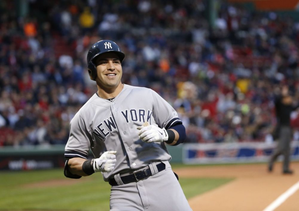 New York Yankees' Jacoby Ellsbury smiles after running to home during the first inning.(AP/Elise Amendola)