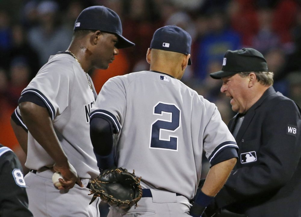 Home plate umpire Gerry Davis confers on the mound with New York Yankees starting pitcher Michael Pineda. (Elise Amendola/AP)