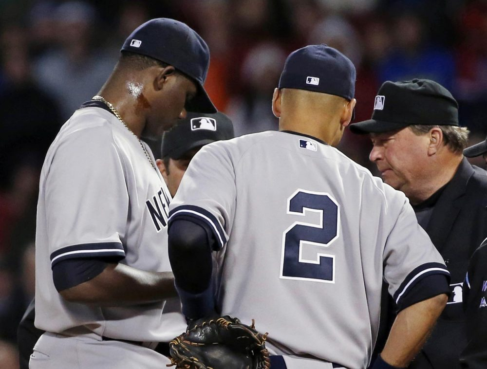 Yankees starting pitcher Michael Pineda was ejected after umpires found with a foreign substance on his neck. (Elise Amendola/AP)