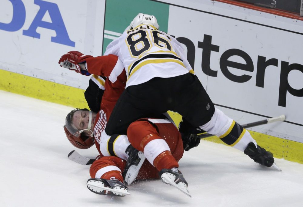 Boston Bruins defenseman Kevan Miller (86) takes down Detroit Red Wings left wing Justin Abdelkader (8) and is called for roughing during the second period. (AP/Carlos Osorio)