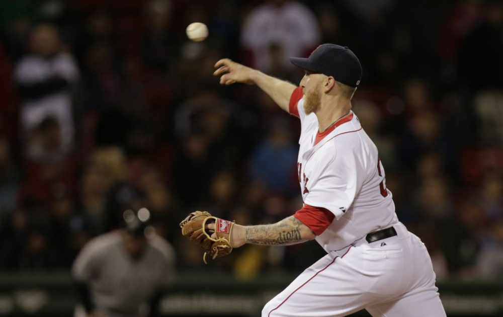 Boston Red Sox left fielder Mike Carp delivers a pitch during the ninth inning.(AP/Charles Krupa)