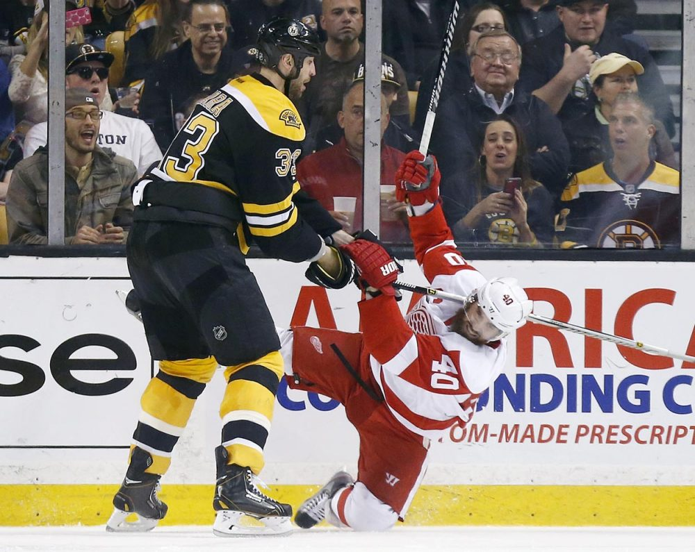 With his size and reach, the Bruins' 6-foot-9 Zdeno Chara is a big problem for opposing forwards. Here, Chara checks Detroit Red Wings' Henrik Zetterberg in Game 5. (Michael Dwyer/AP)