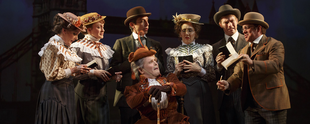 "Jefferson Mays , seated center, with the cast during a performance of ""A Gentleman's Guide to Love and Murder,"" at the Walter Kerr Theatre in New York. (The O+M Company/Joan Marcus/AP)"