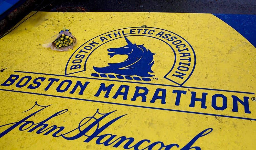 A bouquet of yellow tulips left at the Boston Marathon finish line. (Jesse Costa/WBUR)