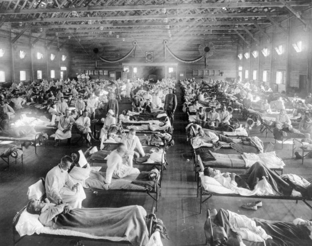 In this 1918 photograph provided by the National Museum of Heath, influenza victims crowd into an emergency hospital at Camp Funston, a subdivision of Fort Riley in Kansas. (AP)