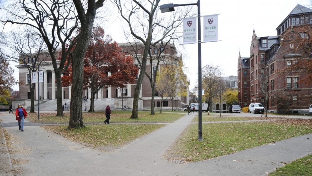 People walk through Harvard Yard at Harvard University. (AP)