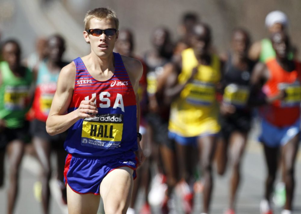 Ryan Hall runs ahead of an elite group of runners in the 2011 Boston Marathon. Hall went on to finish fourth in the race. (Steven Senne/AP)