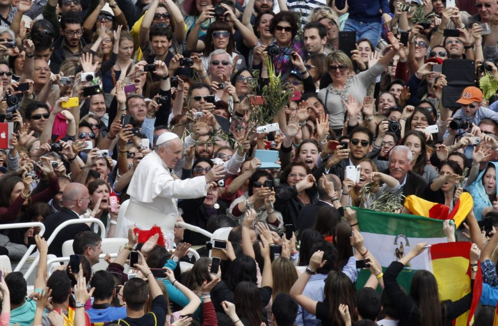 Pope Francis greets faithful at the end of the Palm Sunday Mass in St. Peter's square at the Vatican, Sunday, April 13, 2014. (Riccardo De Luca/AP)