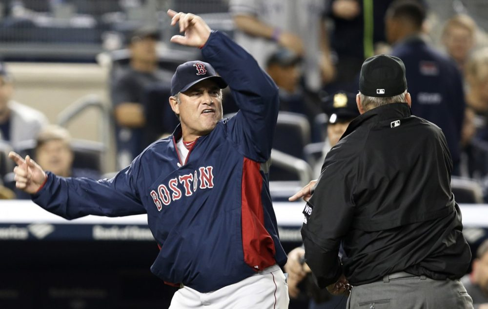 Boston Red Sox manager John Farrell gestures after was was ejected from the game by first base umpire Bob Davidson after Farrell objected to MLB's ruling of an overturned, fourth-inning, force out at first base in a baseball game against the New York Yankees at Yankee Stadium in New York, Sunday, April 13, 2014. The Yankees Brian McCann scored on the play. (AP)