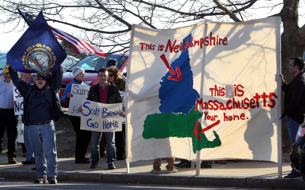 Protesters rally across the street from the hotel where former Massachusetts U.S. Sen. Scott Brown is scheduled to appear, Thursday, April 10, 2014, in Portsmouth, N.H. Brown is expected to announce his plans to seek a U.S. Senate seat from New Hampshire, Thursday. (AP)