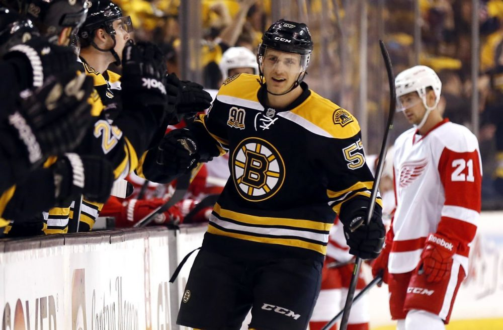 Boston Bruins' Justin Florek is congratulated after scoring a goal in the first period of Game 2 of a first-round NHL hockey playoff series against the Detroit Red Wings. (Winslow Townson/AP)