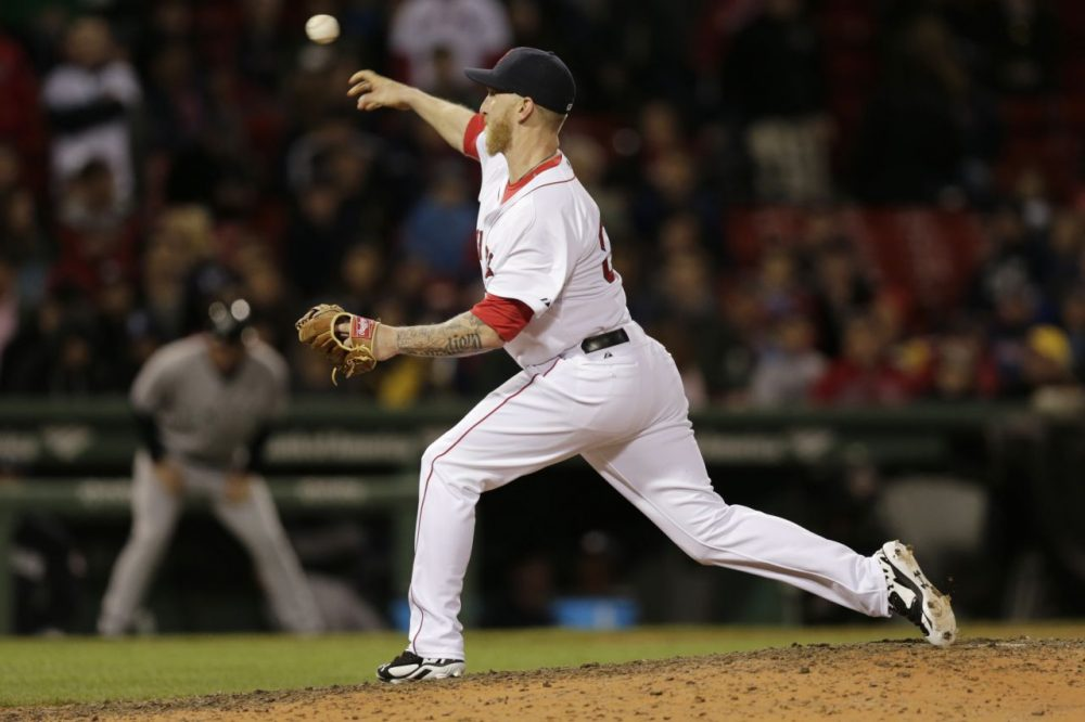 Boston Red Sox's Mike Carp delivers a pitch during the ninth inning of a baseball game against the New York Yankees, Thursday, April 24, 2014, in Boston. (Charles Krupa/AP)