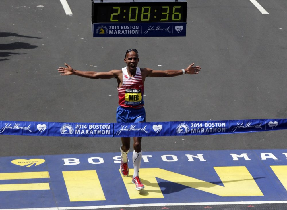 Meb Keflezighi, of San Diego, Calif., celebrates as he crosses the finish line to win the 118th Boston Marathon, Monday, April 21, 2014, in Boston. (AP)