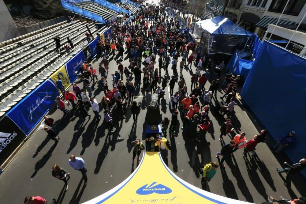 People gather at the finish line ahead of Monday's 118th Boston Marathon, along Boylston Street, Saturday, April 19, 2014, in Boston. (Matt Rourke/AP)