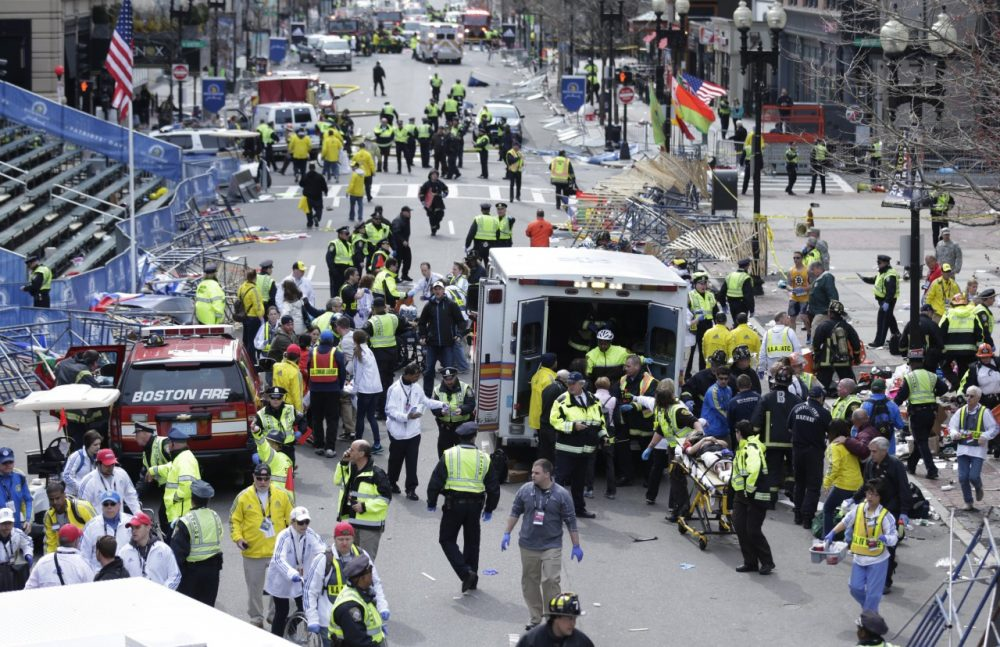 Medical workers aid injured people at the finish line of the 2013 Boston Marathon following an explosion in Boston, Monday, April 15, 2013. (AP)