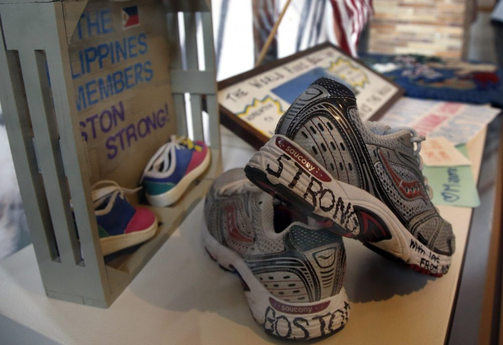 "Part of an exhibit entitled ""Dear Boston: Messages from the Marathon Memorial"" is on display at the Boston Public Library in Boston, Monday, April 7, 2014. Messages of resilience, solidarity, hope and love are embodied at the memorial exhibit commemorating the anniversary of the Boston Marathon bombings. (AP)"