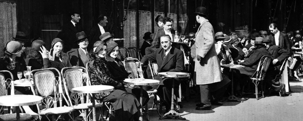 Patrons enjoy the sun outside Weber's Cafe at Rue Royale, around Eastertide in Paris, April 6, 1932.  (AP)