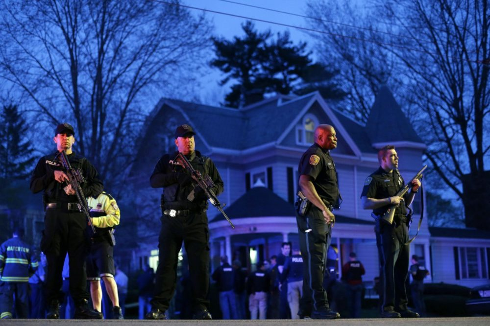 Police officers guard the entrance to Franklin street where there is an active crime scene search for the suspect in the Boston Marathon bombings, Friday, April 19, 2013, in Watertown, Mass. (AP/Matt Rourke)