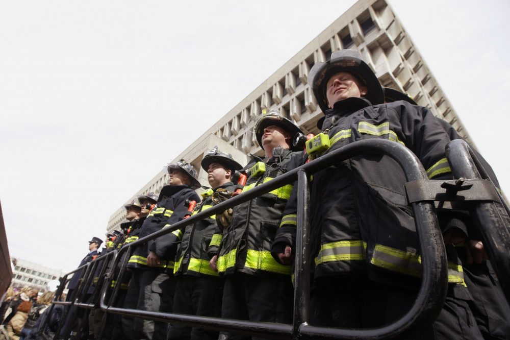 Firefighters from Ladder 15 and Engine 33 during a Boston Fire Department flag raising ceremony in honor of fallen firefighters Michael R. Kennedy and Lt. Edward J. Walsh. (AP/Stephan Savoia)