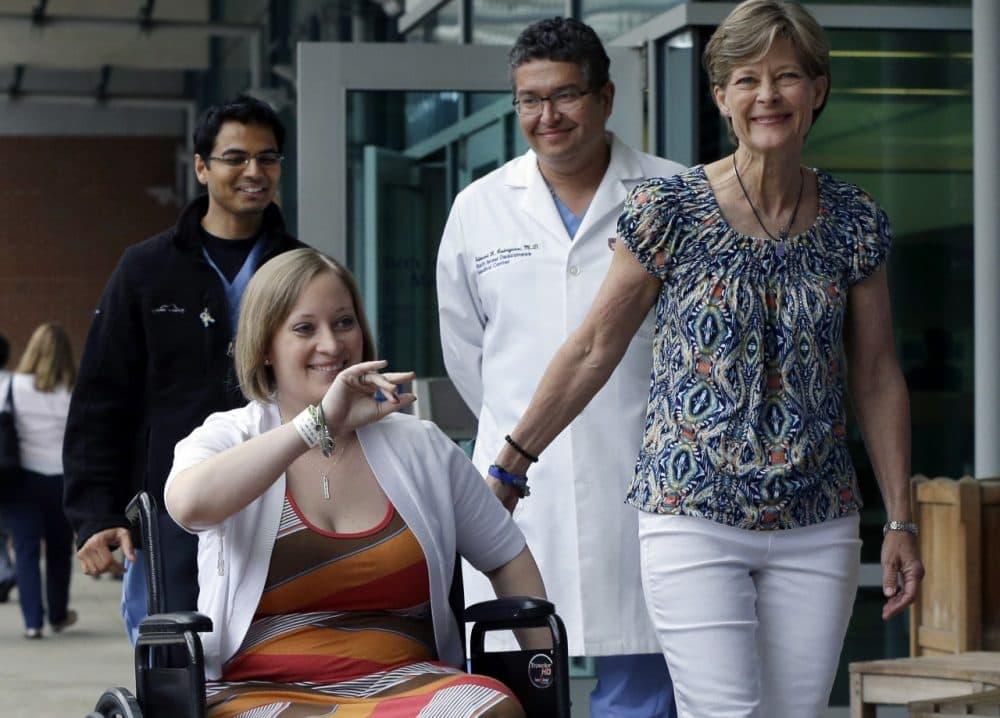 Boston Marathon bombing survivor Erika Brannock, 29, and her mother, Carol Downing, as Brannock is released from Beth Israel Deaconess Medical Center on June 3, 2013. (Elise Amendola/AP)