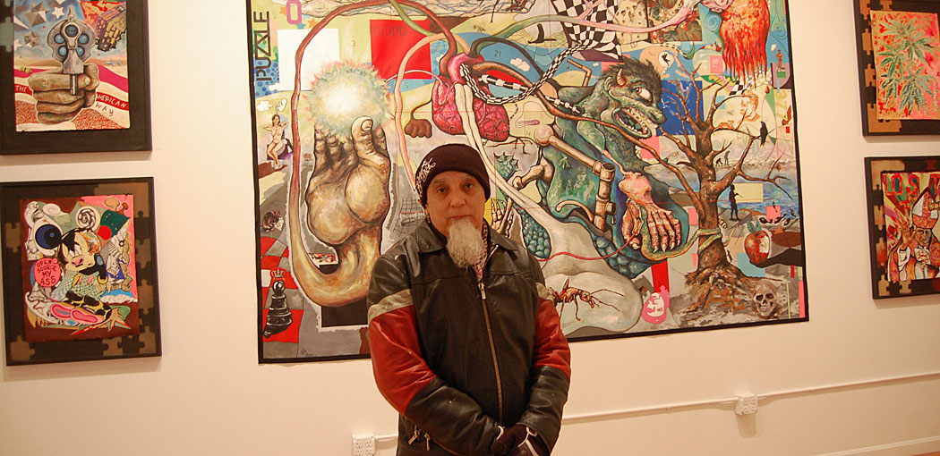 """Bert Crenca at his exhibition """"Puzzled: Ode Owed to Channing."""" (Greg Cook)"""