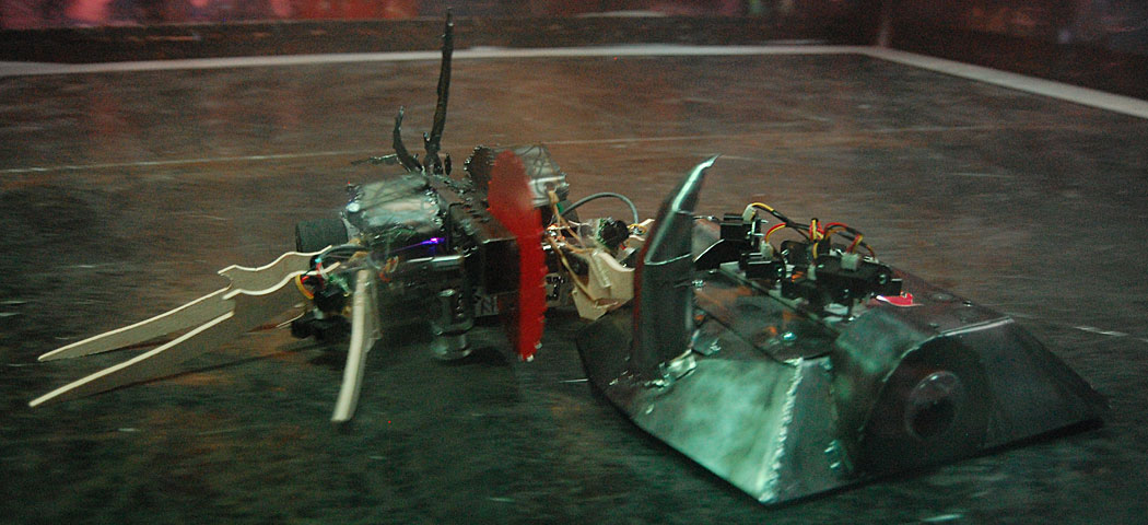 The Plasma Apocalypse robot, with its spinning saw blade (left), clashes with the horned robot constructed by the Somervillians team. (Greg Cook)