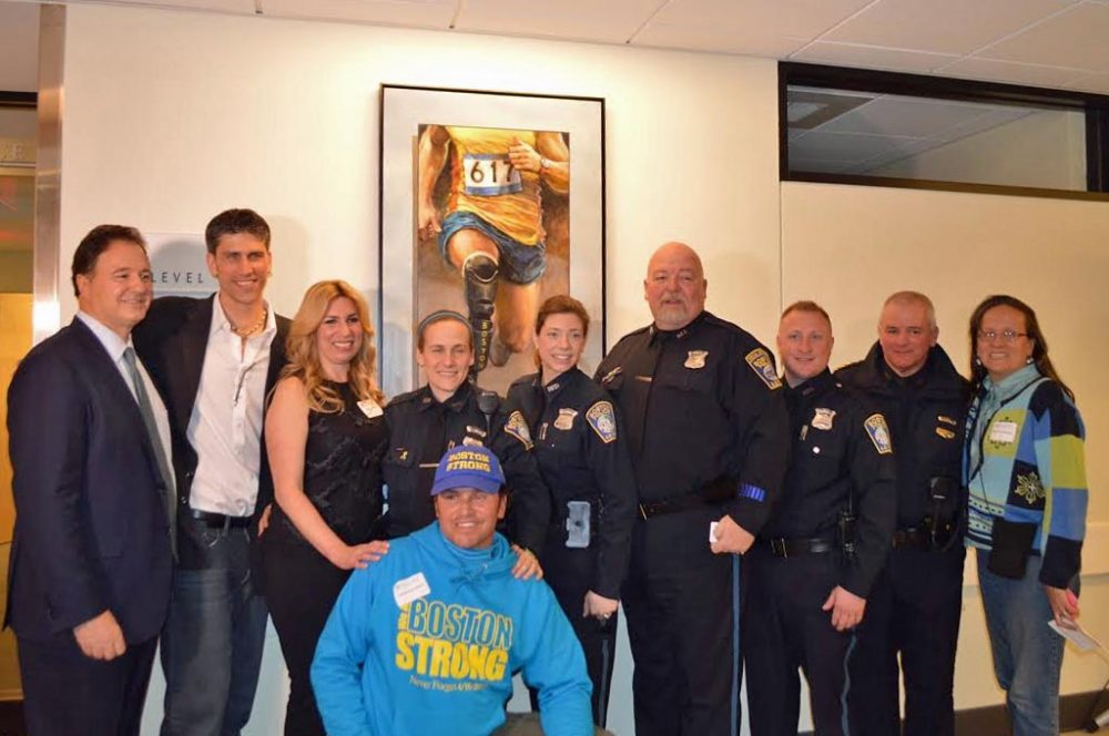 """Boston Marathon bombing survivor Heather Abbott and a group of first responders helped unveil Brian Fox's painting """"Endurance,"""" which will hang at Spaulding Rehab's Charlestown facility. (Courtesy)"""