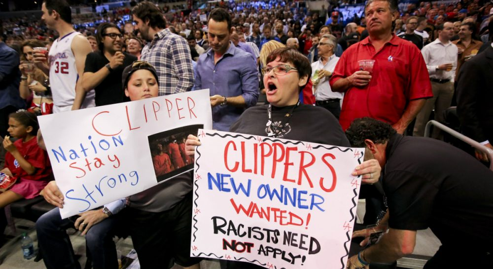 In this photo, fans hold up signs in support of the Los Angeles Clippers before Game 5 of an opening-round NBA basketball playoff series between the Clippers and the Golden State Warriors on Tuesday, April 29, 2014, in Los Angeles. NBA Commissioner Adam Silver announced Tuesday that Clippers owner Donald Sterling has been banned for life by the league. (Ringo H.W. Chiu/AP)