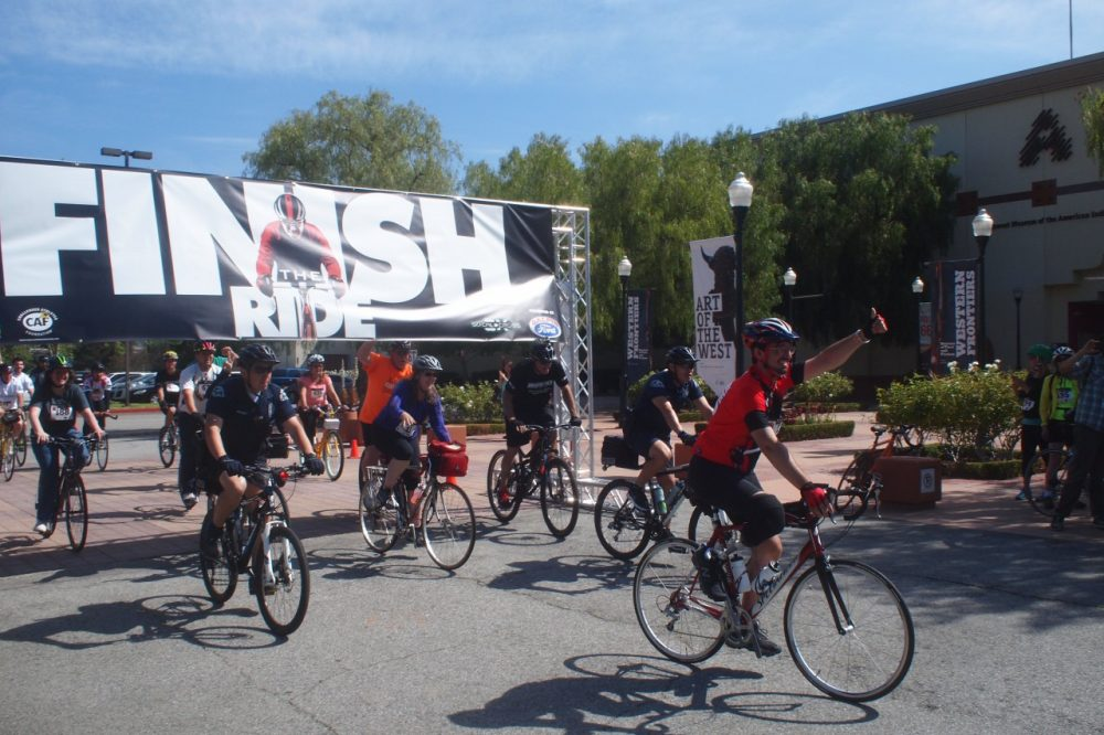 Damian, in red, leads a group of cyclists at the 'Finish the Ride' event. (Kevin Ferguson/Only A Game)