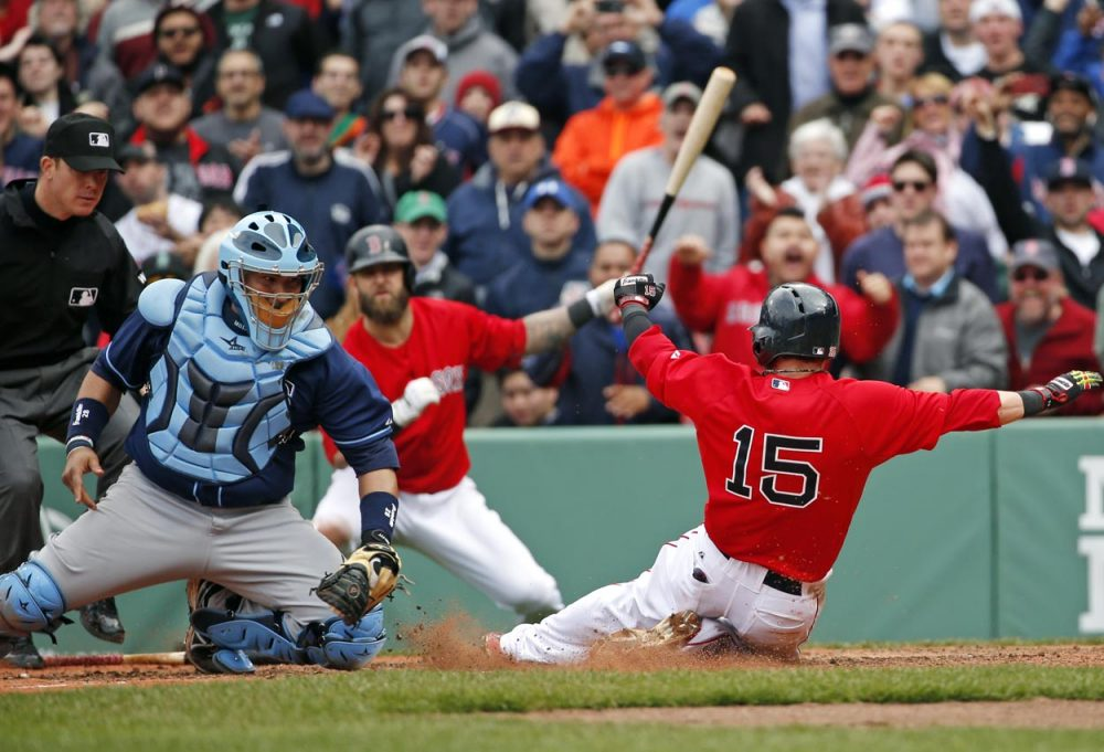 Rays catcher Jose Molina moves to tag out Red Sox' Dustin Pedroia, trying to score on a double by DH David Ortiz Thursday afternoon. (Elise Amendola/AP)